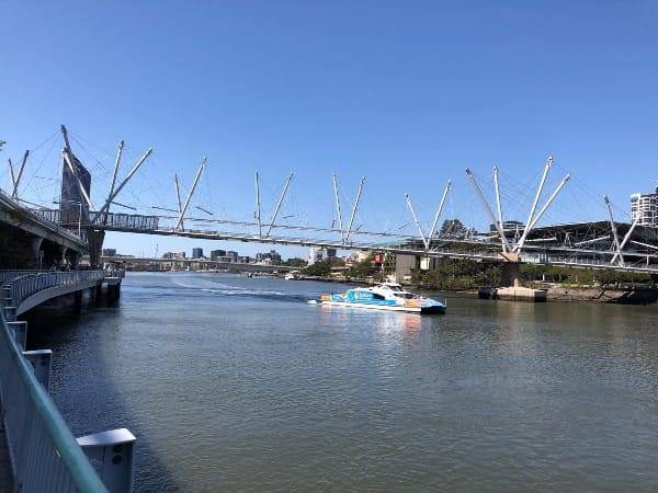 Brisbane CityCat travels under Kurilpa Bridge on the Brisbane River