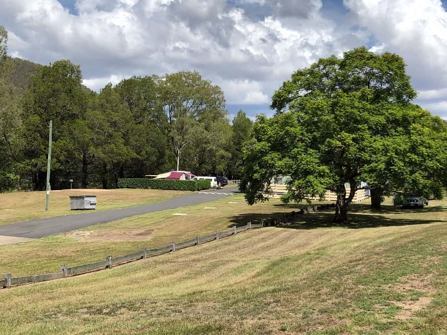 : Camping below Somerset Dam on the banks of the Stanley River at Somerset Park Camp Ground
